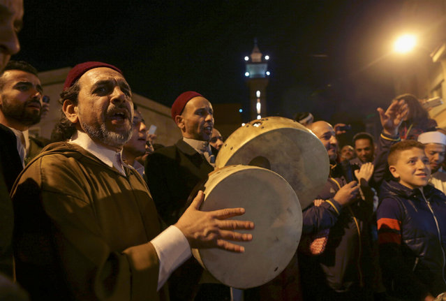 Libyan Sufi Muslims chant and beat drums during a procession celebrating the religious holiday of Mawlid al-Nabi, the birthday of Prophet Mohammad, in Benghazi, Libya December 10, 2016. (Photo by Esam Omran Al-Fetori/Reuters)