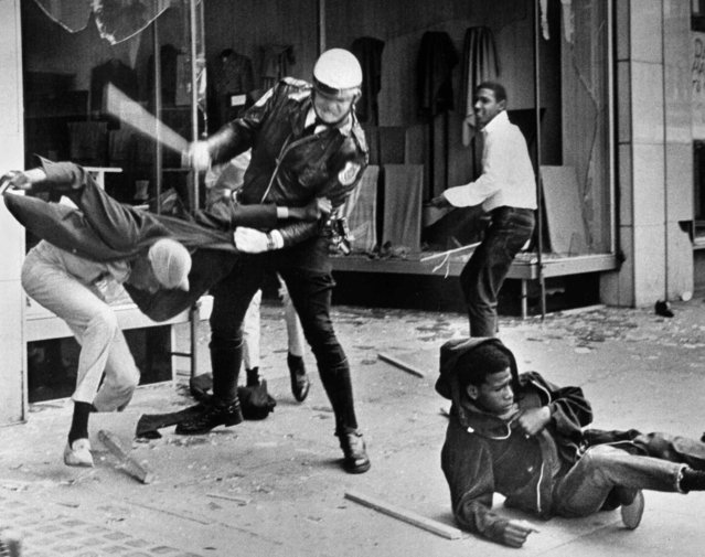 A police officer uses his nightstick on a youth reportedly involved in the looting that followed the breakup of a march led by Dr. Martin Luther King Jr. March 28, 1968, in Memphis, Tenn. Black leaders accused the police of brutality while police officers said they did what was necessary to restore order. In the wake of the violence, a curfew was imposed and more than 3,800 National Guardsmen were rushed to the city. A week later, King was assassinated at Memphis' Lorraine Motel. (Photo by Jack Thornell/AP Photo)