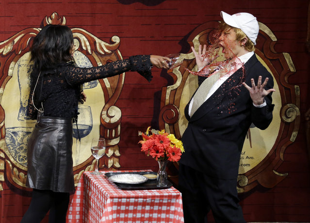 Actress Kerry Washington, Harvard University's Hasty Pudding Theatricals' Woman of the Year, throws wine in the face of an actor playing Republican presidential candidate Donald Trump, Thursday, January 28, 2016, as she is roasted in Cambridge, Mass. (Photo by Elise Amendola/AP Photo)
