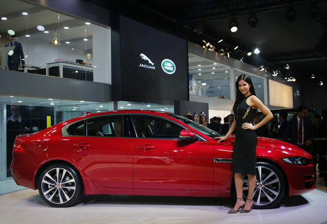 Bollywood actress Katrina Kaif poses with the Jaguar XE during its launch at the Indian Auto Expo in Greater Noida, on the outskirts of New Delhi, India, February 3, 2016. (Photo by Anindito Mukherjee/Reuters)
