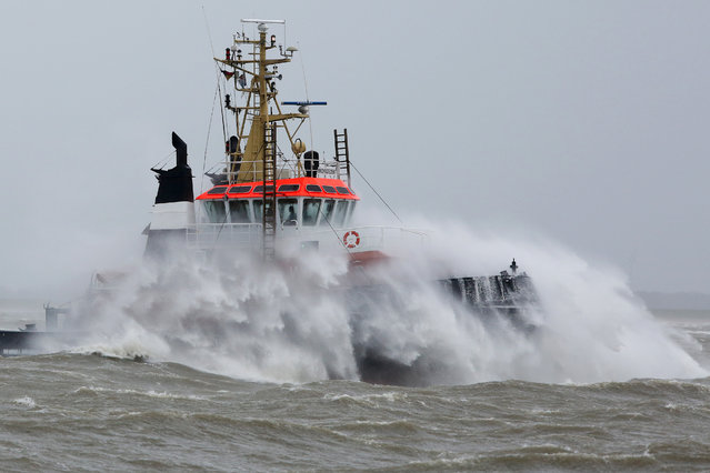 "Waves crash against a towboat during heavy winds on the river Elbe near Brunsbuettel, northern Germany, Tuesday, March 31, 2015. Wide parts of Germany were hit by storm ""Niklas"". (Photo by Bodo Marks/AP Photo/DPA)"
