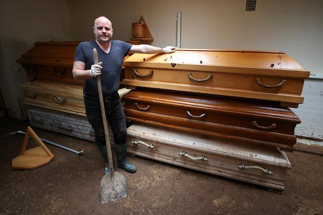 Undertaker Gerth Lethert poses at his workshop in an area affected by floods caused by heavy rainfalls in Bad Muenstereifel, Germany, July 19, 2021. (Photo by Wolfgang Rattay/Reuters)
