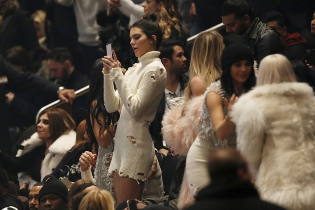 "Kendall Jenner uses her cellular device during Kanye West's Yeezy Season 3 Collection presentation and listening party for the ""The Life of Pablo"" album during New York Fashion Week February 11, 2016. (Photo by Andrew Kelly/Reuters)"