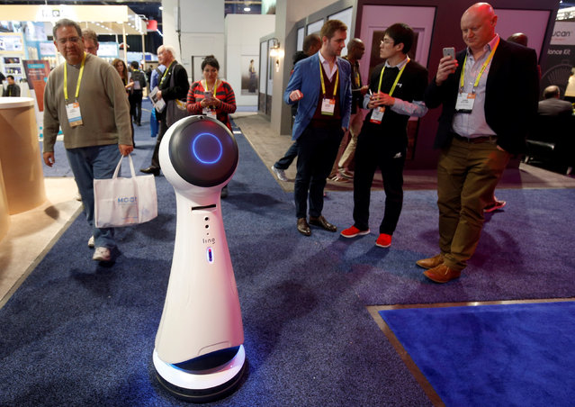Wavebot, a service robot by Ling, travels down an aisle on the trade show floor during the 2017 CES in Las Vegas, Nevada January 6, 2017. (Photo by Steve Marcus/Reuters)