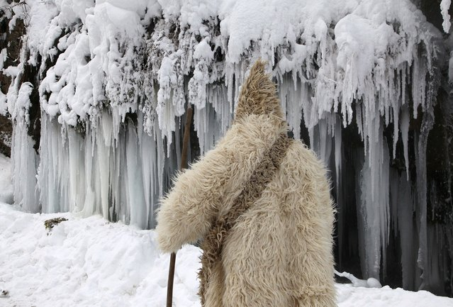 A man passes by a frozen waterfall at around minus 26 degrees Celsius (minus 14.8 degrees Fahrenheit) in the village of Jezerc, Kosovo January 8, 2017. (Photo by Hazir Reka/Reuters)