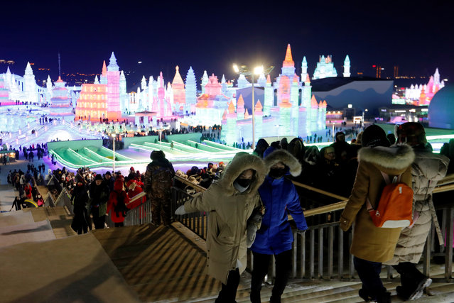 Ice sculptures illuminated by colored lights at the annual ice festival, in the northern city of Harbin, Heilongjiang province, China on January 4, 2019. (Photo by Tyrone Siu/Reuters)