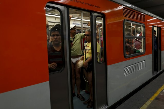 """Passengers not wearing pants stand is a subway train during the """"No Pants Subway Ride"""" in Mexico City, Mexico, February 21, 2016. (Photo by Carlos Jasso/Reuters)"""