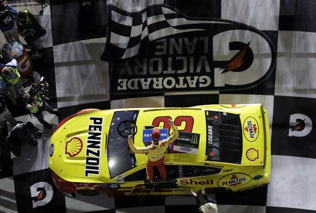 Joey Logano (22) climbs onto his car as he celebrates his win in the second NASCAR Daytona 500 qualifying auto race Thursday, February 14, 2019, at Daytona International Speedway in Daytona Beach, Fla. (Photo by Chris O'Meara/AP Photo)