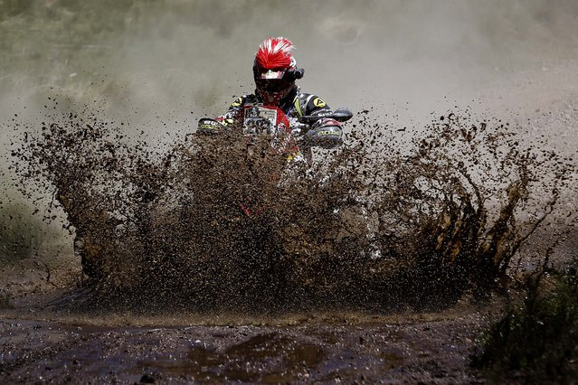 Yamaha rider Juan Carlos Carignani of Italy rides his quad through a creek during the first stage of the Dakar Rally between the cities of Rosario and San Luis in San Luis, Argentina, on January 5, 2014. (Photo by Victor R. Caivano/Associated Press)