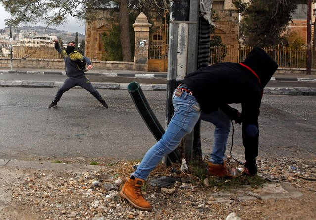 A Palestinian protester uses a sling to hurl stones towards Israeli troops during clashes in the West Bank city of Bethlehem January 26, 2017. (Photo by Mussa Qawasma/Reuters)