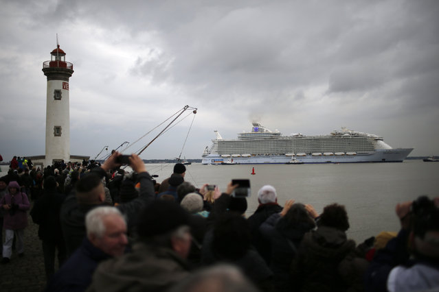 The Harmony of the Seas ( Oasis 3 ) class ship leaves the STX Les Chantiers de l'Atlantique shipyard site in Saint-Nazaire, France, March 10, 2016. The city's STX France shipyards began building the €1bn ($1.1bn) mammoth for US shipbuilder Royal Caribbean International (RCI) in September 2013. (Photo by Stephane Mahe/Reuters)