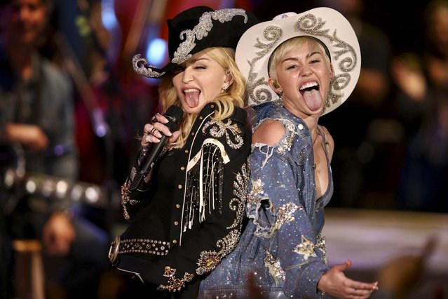 "Miley Cyrus performs with Madonna for MTV, on January 28, 2014. The 21-year-old pop star and the 55-year-old Queen of Pop grinded and grabbed each other as they performed Cyrus' hit ""We Can't Stop"" and Madonna's 2000 track ""Don't Tell Me""  Tuesday during a taping in Hollywood. The ""MTV Unplugged"" special that closes with the duet is set to air Wednesday. (Photo by Sandy M. Cohen/MTV)"