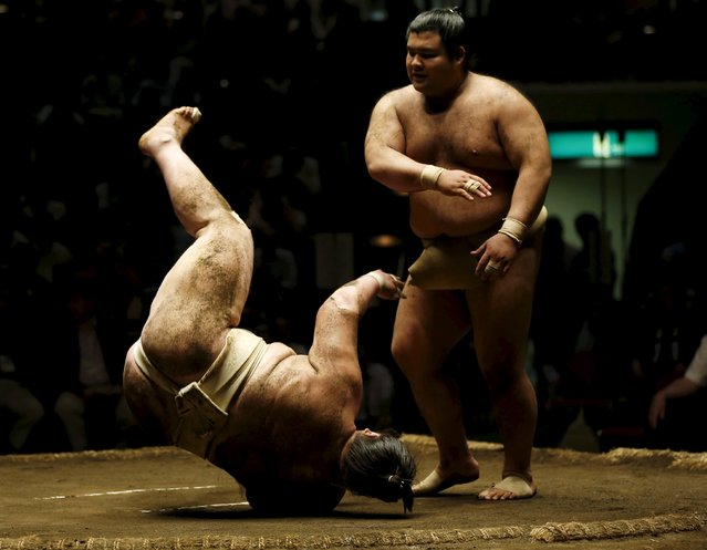 Sumo wrestler Takayasu (R) throws Mongolian-born Ichinojo during their joint training session for Nishonoseki clan ahead of the May Grand Sumo Tournament in Tokyo May 2, 2015. (Photo by Toru Hanai/Reuters)