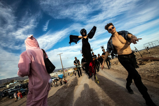 The Axon Orchestra performs with visitors dancing in a procession on the shore of the Salton Sea Lake during the Bombay Beach Biennale, in Bombay Beach, south of Palm Springs, California, USA, 23 March 2019. (Photo by Etienne Laurent/EPA/EFE)