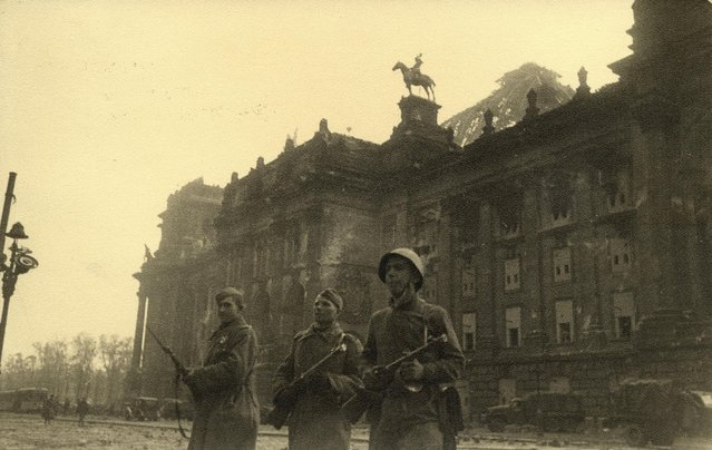 Russian soldiers are pictured in front of the Reichstag building in this undated photo taken May 1945 in Berlin. (Photo by Georgiy Samsonov/Reuters/MHM)