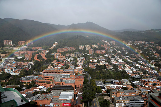 A rainbow appears over the eastern hills in Bogota, Colombia August 9, 2018. (Photo by Luisa Gonzalez/Reuters)