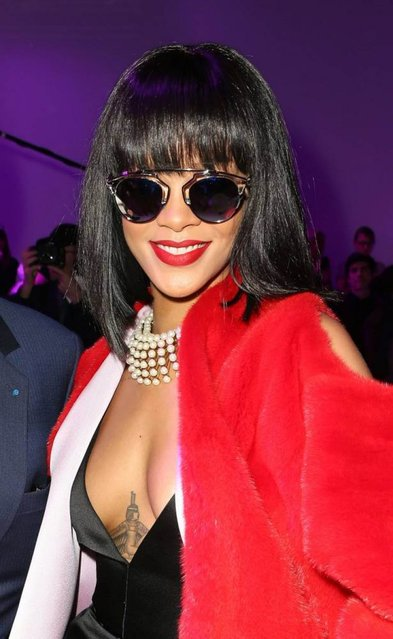 Barbadian singer Rihanna attends the presentation of the Christian Dior fall/winter 2014 /2015 collection during the Paris Pret a porter fashion week, in Paris, France, 28 February 2014. Paris Pret a porter fashion shows run until 5 March 2014. (Photo by Hendrik Ballhausen/AP Images/DPA)
