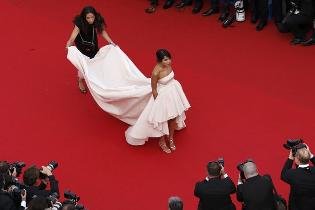 """Actress Leila Bekhti poses on the red carpet as she arrives for the opening ceremony and the screening of the film """"La tete haute"""" out of competition during the 68th Cannes Film Festival in Cannes, southern France, May 13, 2015. (Photo by Benoit Tessier/Reuters)"""