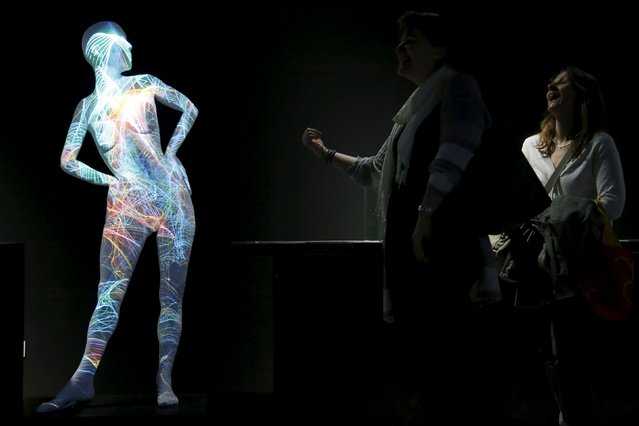 "Visitors observe a 3D model of a female body as they visit the ""Gallery of Humankind. Our evolution, our body"" exhibition at the Museum of Natural Sciences in Brussels, Belgium, May 22, 2015. (Photo by Francois Lenoir/Reuters)"