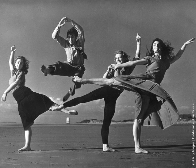 1953: Saint James Ballet Company limber up on the beach at Burnham in Somerset