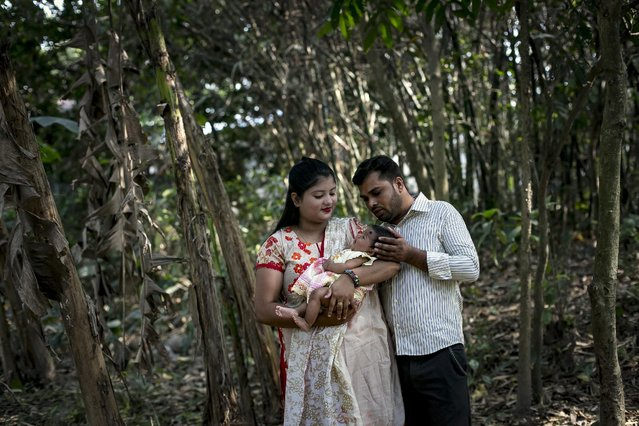 Meghla poses for a photo with her baby and her husband, Liton, on March 7, 2017 in Khulna division, Bangladesh. (Photo by Allison Joyce/Getty Images)