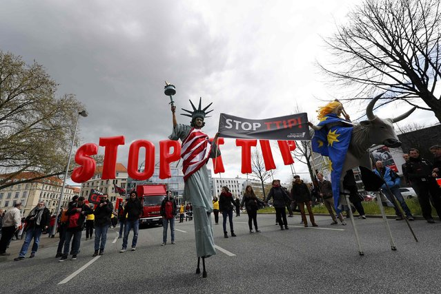 Protesters depicting Statue of Liberty (L) and Europa on the bull take part in a demonstration against Transatlantic Trade and Investment Partnership (TTIP) free trade agreement ahead of U.S. President Barack Obama's visit in Hannover, Germany April 23, 2016. (Photo by Kai Pfaffenbach/Reuters)