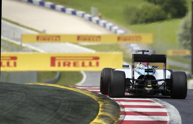 Williams driver Felipe Massa of Brazil steers his car during the the Formula One Grand Prix race, at the Red Bull Ring in Spielberg, southern Austria, Sunday, June 21, 2015. (AP Photo/Darko Bandic)