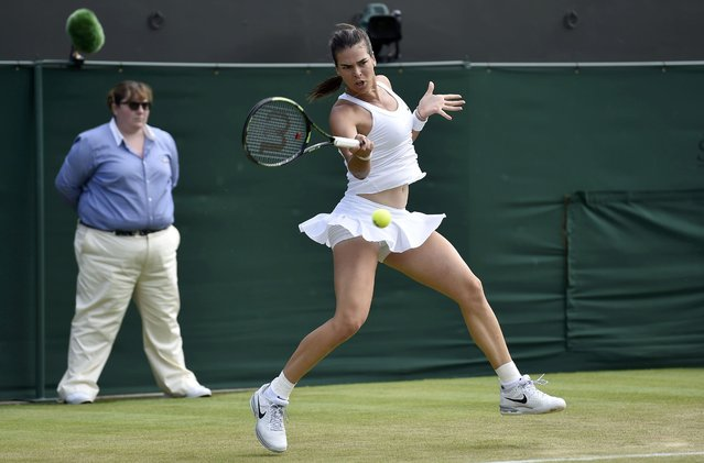 Ajla Tomljanovic of Australia hits a shot during her match against Agnieszka Radwanska of Poland at the Wimbledon Tennis Championships in London, July 2, 2015. (Photo by Toby Melville/Reuters)
