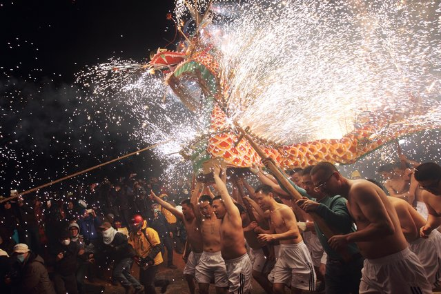 """""""Fire Dragon"""". Taken in Fung Shun, Gaung Dong, China, this event held annually on the second month of Lunar calendar. Photo location: Fung Shun, Gaung Dong, China. (Photo and caption by Chan Kwok Hung/National Geographic Photo Contest)"""