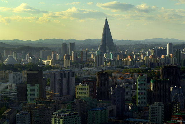 View of Ryugyong Hotel (the unfinished and unoccupied pyramid-style hotel) among towering apartments and other high rises in Pyongyang, North Korea on May 4, 2016. (Photo by Linda Davidson/The Washington Post)