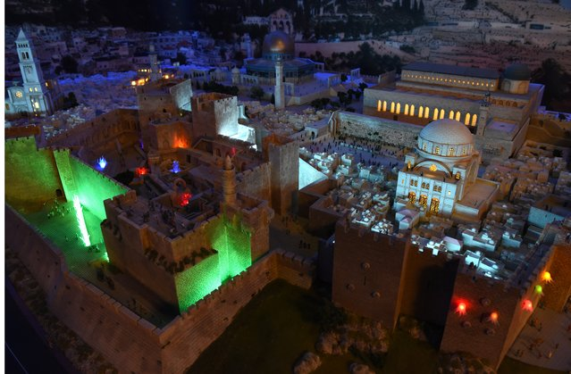 A miniature model of the Old City of Jerusalem and its walls, part of Gulliver's Gate, a miniature world being recreated in a 49,000-square-foot exhibit space in Times Square, is seen during a preview April 10, 2017 in New York City. (Photo by Timothy A. Clary/AFP Photo)