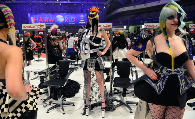 """Models wait after the contest """"Full Fashion Look"""" for the rating of the jury during the OMC Hairworld World Cup on May 4, 2014 in Frankfurt am Main, Germany. (Photo by Thomas Lohnes/Getty Images)"""