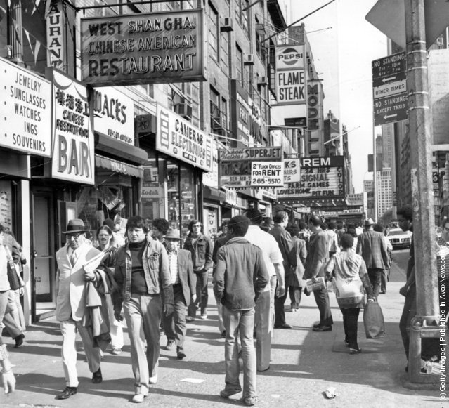 1975: Shoppers on West 42nd Street between 7th and 8th Avenues in the Times Square area of New York
