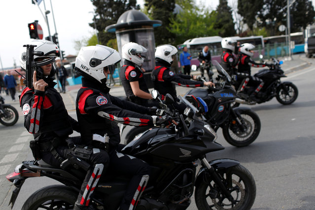 Turkish police ride motorcycles during the May Day in Istanbul, Turkey on May 1, 2017. (Photo by Murad Sezer/Reuters)