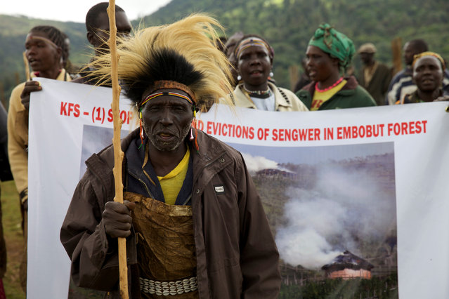 People from the Sengwer community protest over their eviction from their ancestral lands, Embobut Forest, by the government for forest conservation in western Kenya, April 19, 2016. (Photo by Katy Migiro/Reuters)
