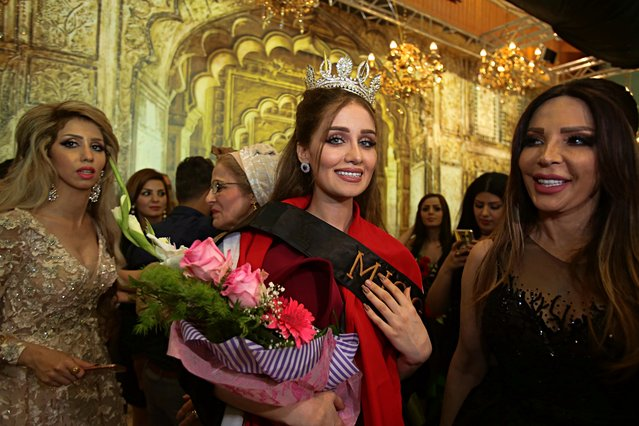 Vian Salman, center, smiles with fellow contestants after she was crowned the new Miss Iraq during the Miss Iraq contest in Baghdad, Iraq, Thursday, May 25, 2017. (Photo by Karim Kadim/AP Photo)