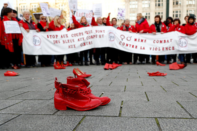 Red shoes are placed on the ground during a demonstration against all kinds of violence towards women in central Brussels, Belgium on November 24, 2019. (Photo by Francois Lenoir/Reuters)