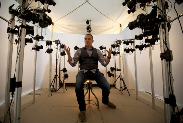 James Enright, CEO of  Propshop, sits in a scanning and photogrammetry rig at the company's headquarters at Pinewood studios near London, Britain May 25, 2016. (Photo by Peter Nicholls/Reuters)