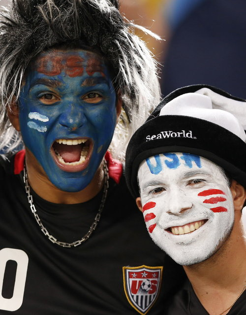 USA fans cheer before the group G World Cup soccer match between Ghana and the United States at the Arena das Dunas in Natal, Brazil, Monday, June 16, 2014. (Photo by Julio Cortez/AP Photo)