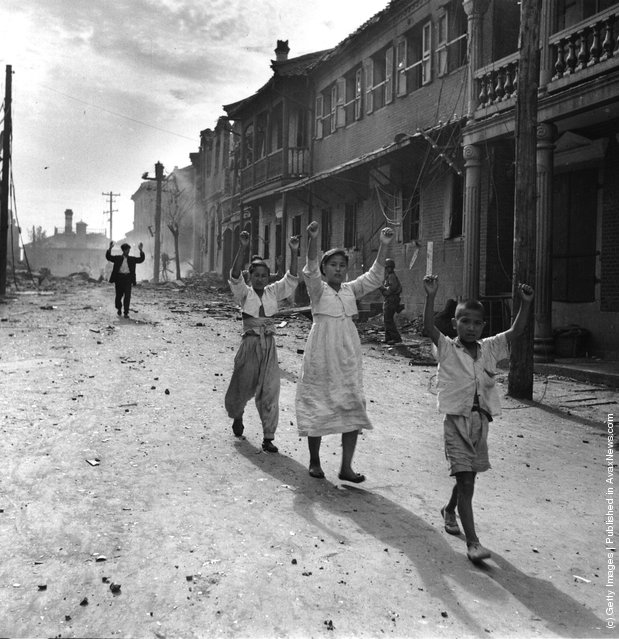 Residents of the Korean port of Inchon surrender to American troops