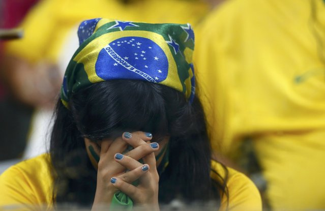 A Brazil fan reacts during the 2014 World Cup semi-finals between Brazil and Germany at the Mineirao stadium in Belo Horizonte July 8, 2014. (Photo by Eddie Keogh/Reuters)