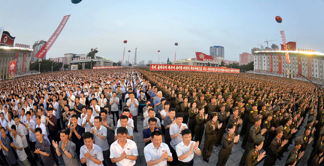 Army personnel and people gather at Kim Il Sung Square in Pyongyang July 6, 2017 to celebrate the successful test-launch of intercontinental ballistic rocket Hwasong-14. in this photo released by North Korea's Korean Central News Agency (KCNA) in Pyongyang July 7, 2017. (Photo by Reuters/KCNA)