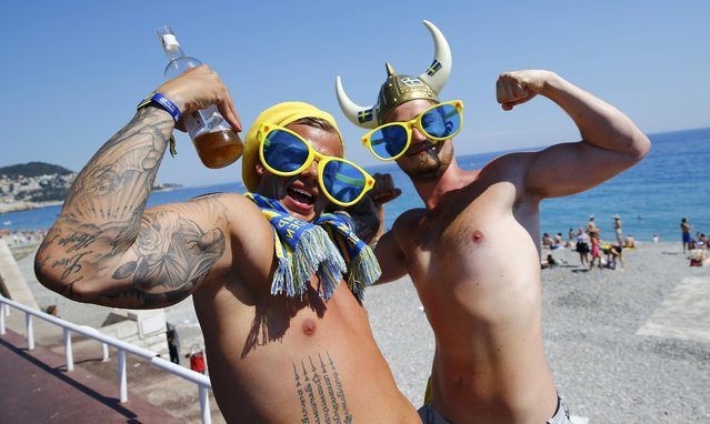 Football Soccer, Euro 2016, Nice, France on June 22, 2016. Sweden fans enjoy the beach ahead of the game against Belgium in Nice, France. (Photo by Wolfgang Rattay/Reuters)