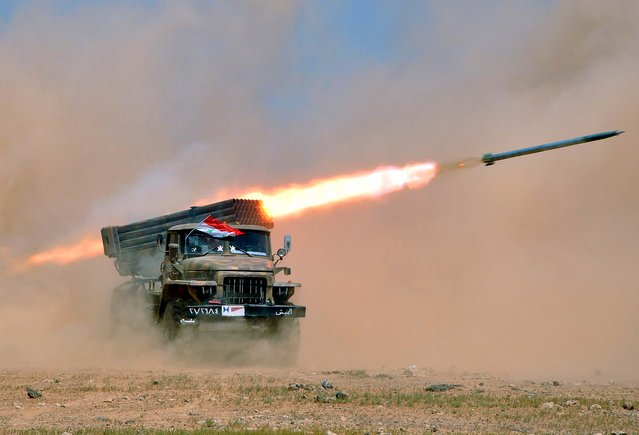 Syrian troops participate in a live fire exercise in an undisclosed location in Syria on July 8, 2012