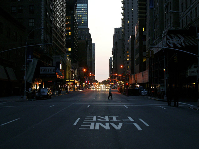 The first lights come on at 53rd and Broadway during the east coast blackout August 15, 2003 in New York City. (Photo by Matthew Peyton/Getty Images)