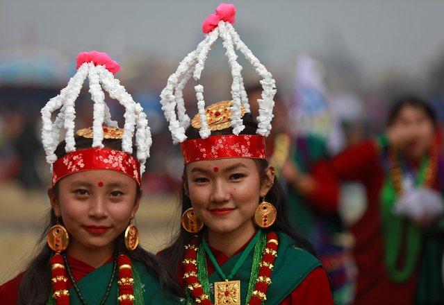 Gurung girls wearing a traditional costume pose as they take part in Tamu Lhosar parade, marking the beginning of the Gurung community's new year, in Kathmandu, Nepal, December 31, 2019. (Photo by Monika Deupala/Reuters)