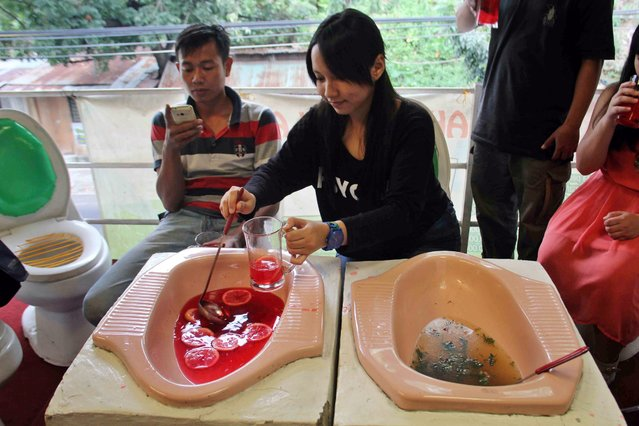 "A picture made available on 21 July 2016 shows a visitor having a meal from a toilet bowl at ""Jamban Cafe"" (lit. Toilet Cafe) in Semarang, Central Java, Indonesia, 16 July 2016. The cafe was created by a sanitation expert for education purposes to stress the importance of using a dedicated toilet and keeping it clean to prevent disease. (Photo by EPA/Purwanto)"