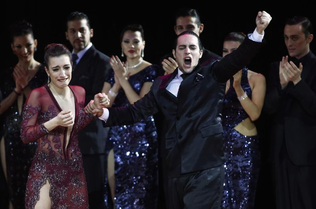 Manuela Rossi (L) and Juan Malizia Gatti from Argentina celebrate winning the Tango World Championship in Stage style in Buenos Aires August 26, 2014. (Photo by Marcos Brindicci/Reuters)