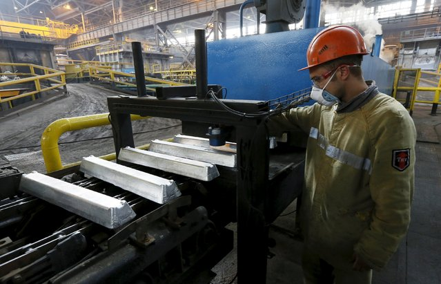 A worker watches aluminium ingots on a conveyor belt at the Rusal Sayanogorsk aluminium smelter outside the town of Sayanogorsk, Russia, September 3, 2015. (Photo by Ilya Naymushin/Reuters)