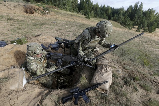 "Danish soldiers take part in a live fire exercise in a tactical environment ahead of the ""Silver Arrow"" drill in Adazi training field, Latvia,  September 5, 2015. (Photo by Ints Kalnins/Reuters)"